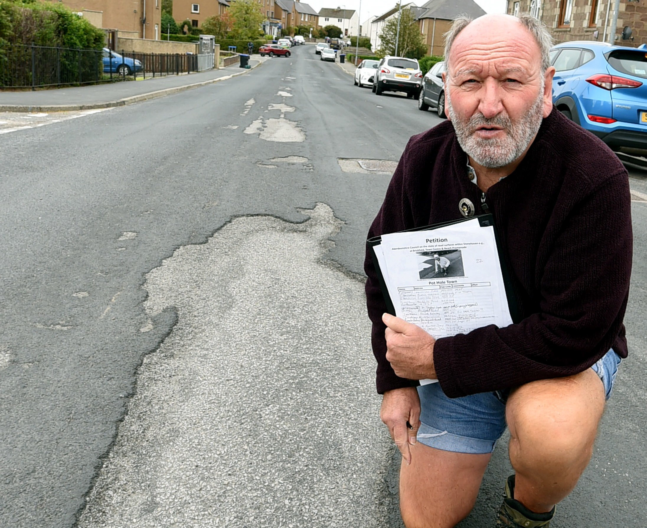 Phil Mills-Bishop with his pothole petition.