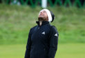 Tyrell Hatton reacts to his missed putt on the 18th