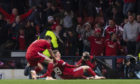 Lewis Ferguson celebrates his goal in front of the Aberdeen supporters.