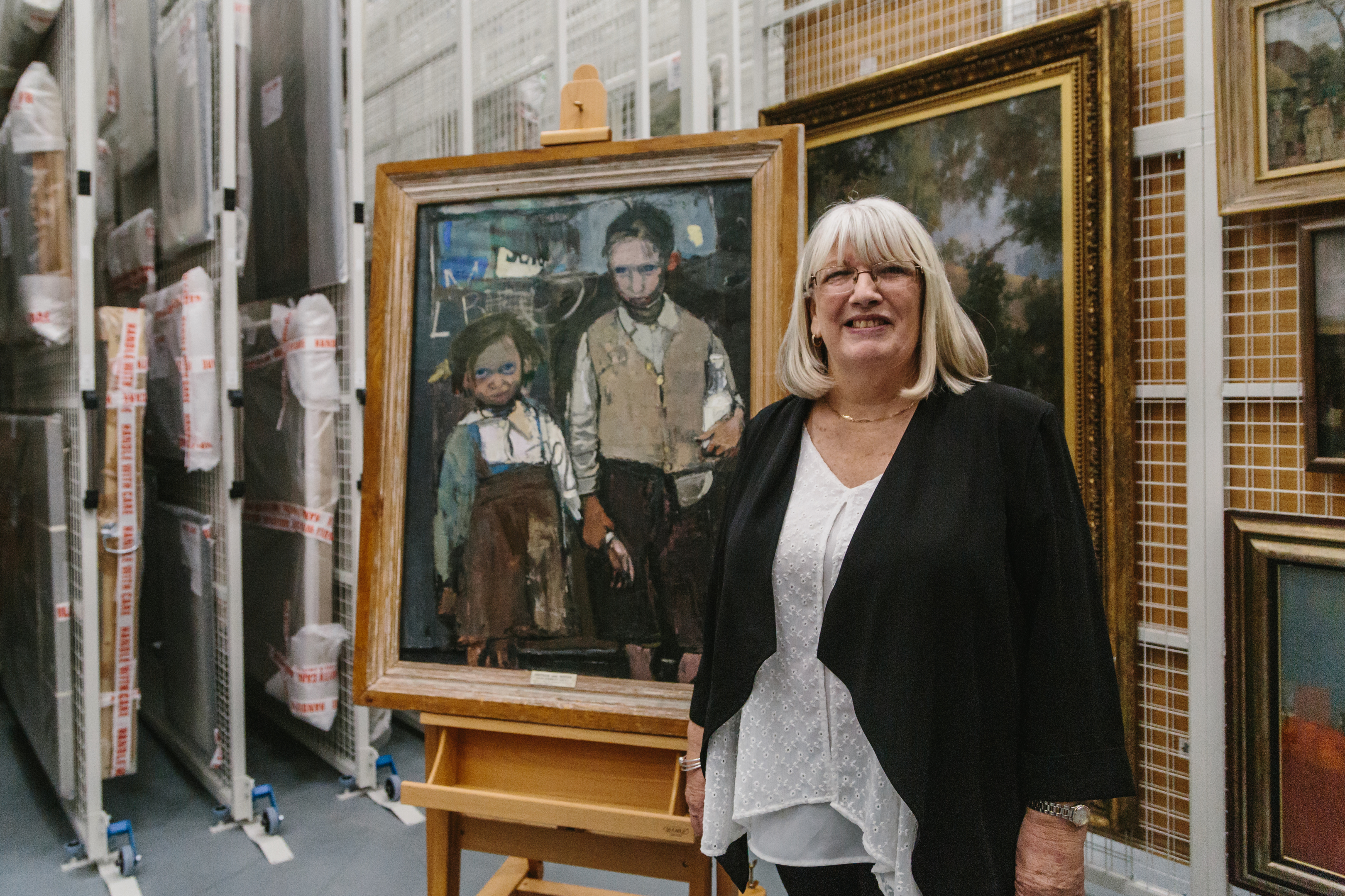 Margaret with the painting. (Picture: Grant Anderson)