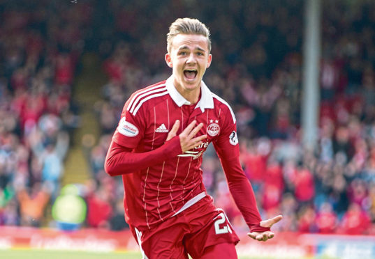 Aberdeen's James Maddison celebrates scoring at Pittodrie.