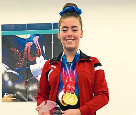 Aberdeen gymnast Orianne Slater with her medals from the Disability Artistic British Championships at Telford.
