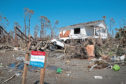 MEXICO BEACH, FL - OCTOBER 13:  Storm debris litters the town after Hurricane Michael on October 13, 2018 in Mexico Beach, Florida. Hurricane Michael slammed into the Florida Panhandle on October 10, as a category 4 storm causing massive damage and claiming the lives of 17 people.  (Photo by Scott Olson/Getty Images)