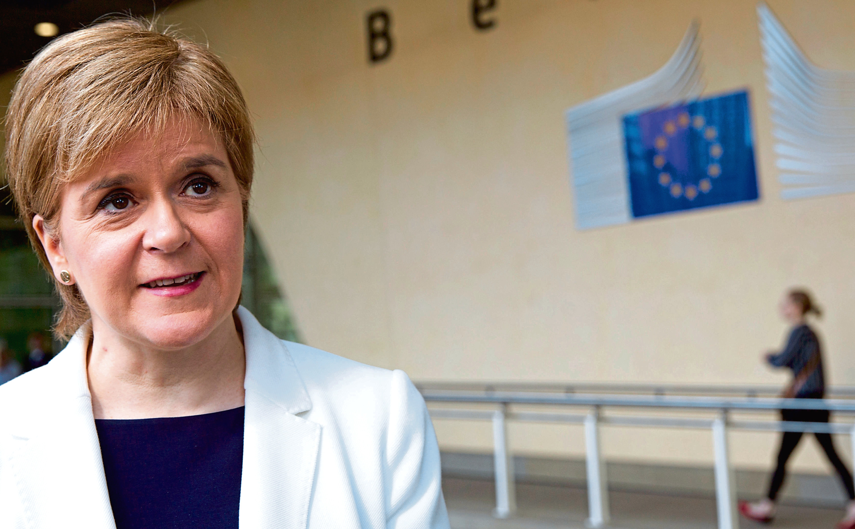 Scotland's Prime Minister Nicola Sturgeon speaks with the media outside EU headquarters in Brussels.