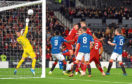 Fergie time: The Dons midfielder heads home the winner against Rangers.