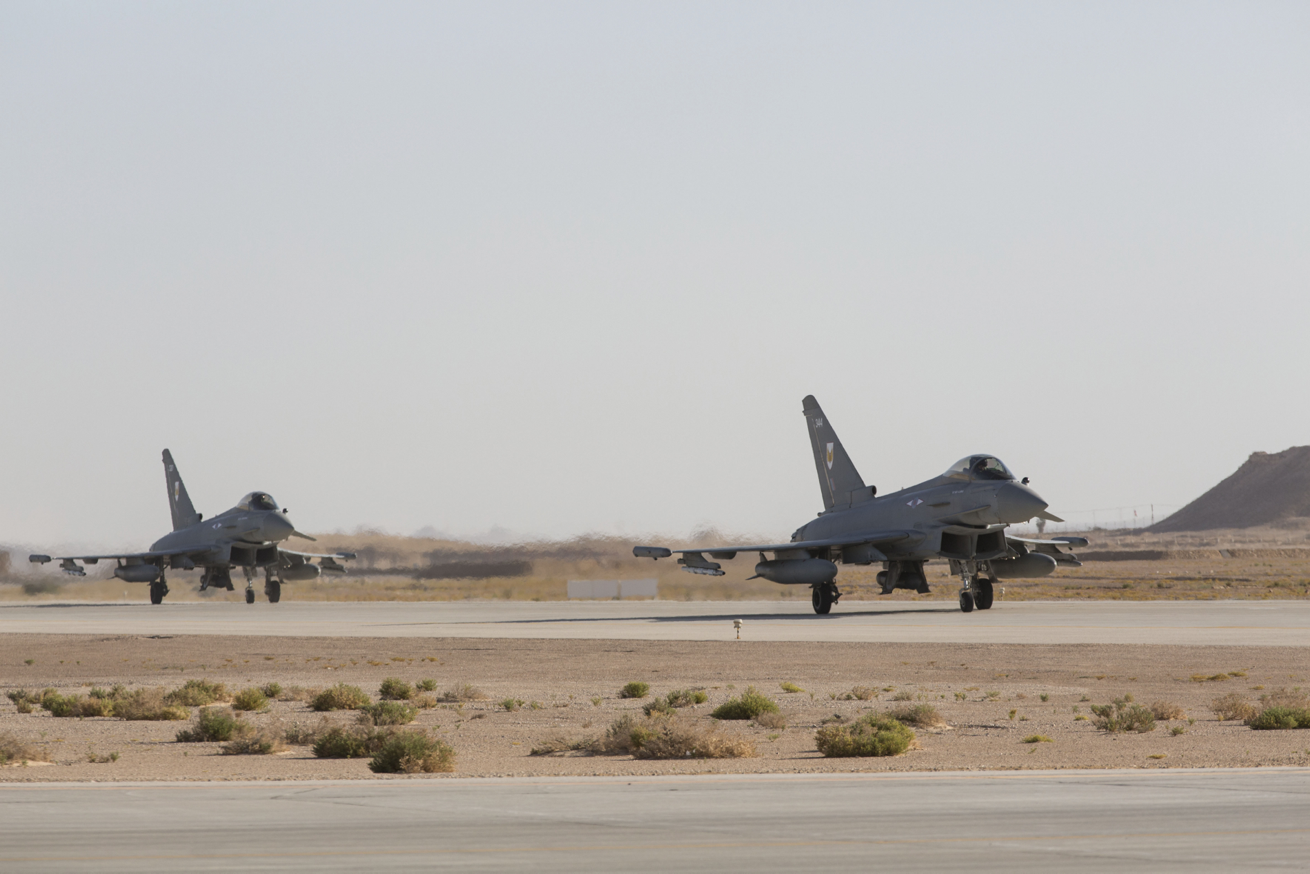 Pictured are Typhoons from RAF Lossiemouth's II (Army Cooperation) Squadron arriving at Thumrait Airbase.