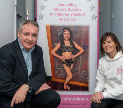 Moray MSP Richard Lochhead and Abbie's mum, Tammy Main, launch the competition to design a Christmas card to support Abbie's Sparkle Foundation.