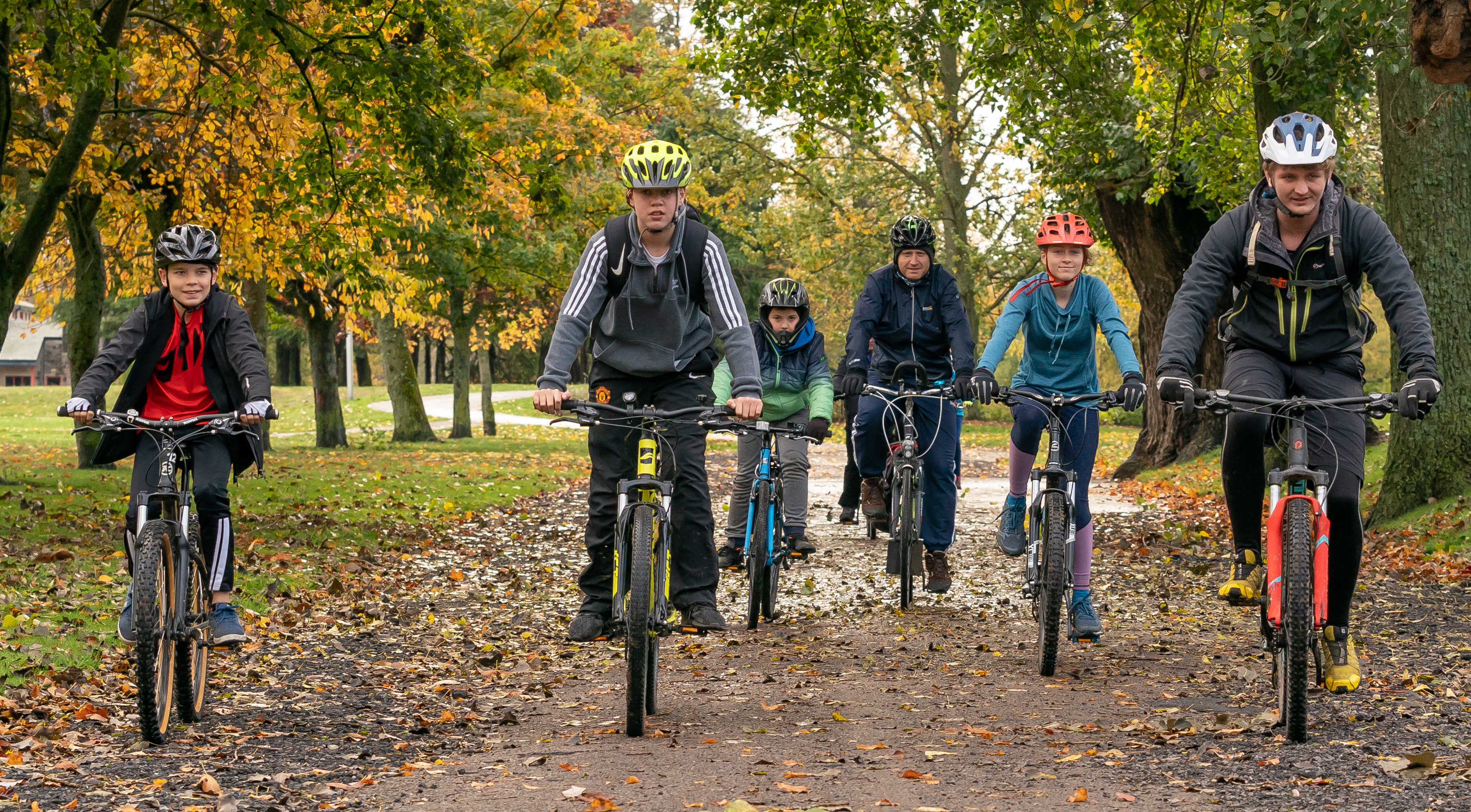This is a scene from Bikefest as part of Elgin Youth Café's Inspiration Week at Coper park, Elgin, Moray on Sunday 14 October 2018. Photographed by JASPERIMAGE ©. PICTURE CONTENT:- Right, David Brackpool of Outfir Moray, leads the Cyclist away from Cooper park to Lossiemouth.