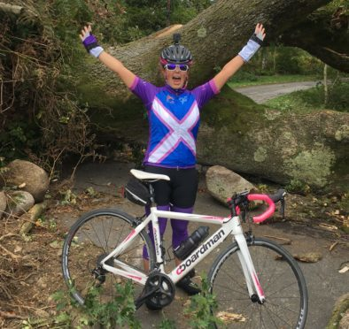 Louise Cruickshank at a fallen tree in the Borders.