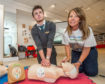 CPR training taking place at St Giles shopping centre with Sandra MacKandie alongside Keiran's childhood friend Ross Clarke.