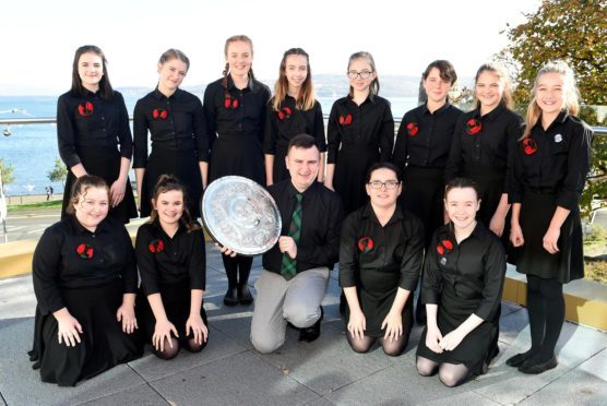 Dunoon 2018. Rionnagan Rois from throught Ross-shire, winners of the Queen Elizabeth (1937) Coronation Trophy being held by conductor Ross Brindle.