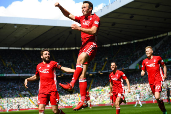 Andy Considine celebrates his winner against Celtic in May 2018.