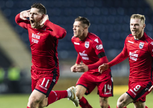 Iain Vigurs celebrates levelling the scores for Ross County.