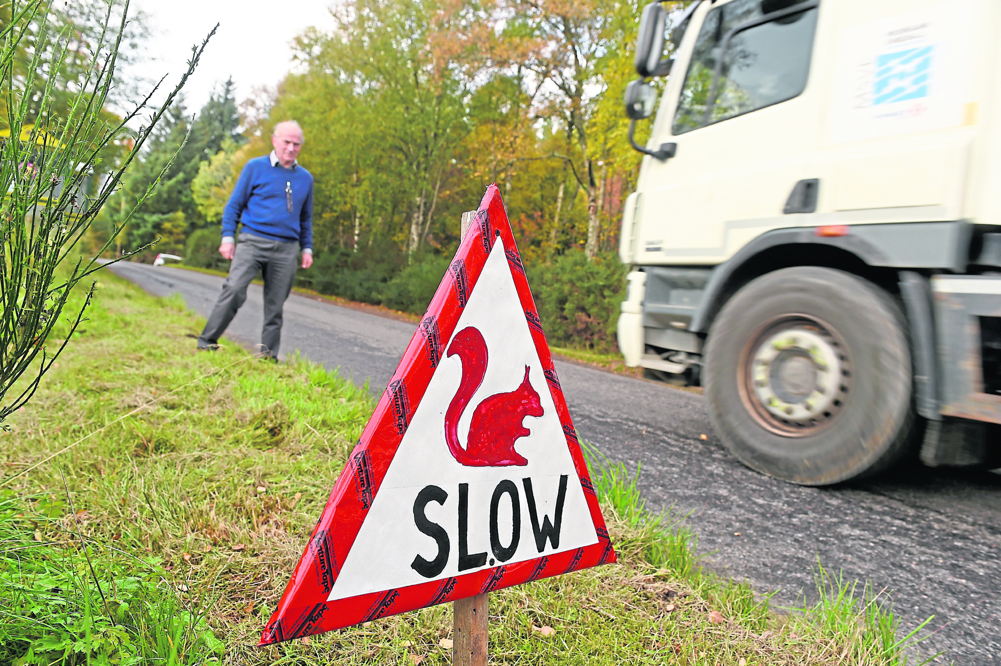 James Murray, chairman of the Strathnairn Community Council, with a warning sign for road drivers after a number of red squirrels have been killed on local roads. Picture by Sandy McCook.