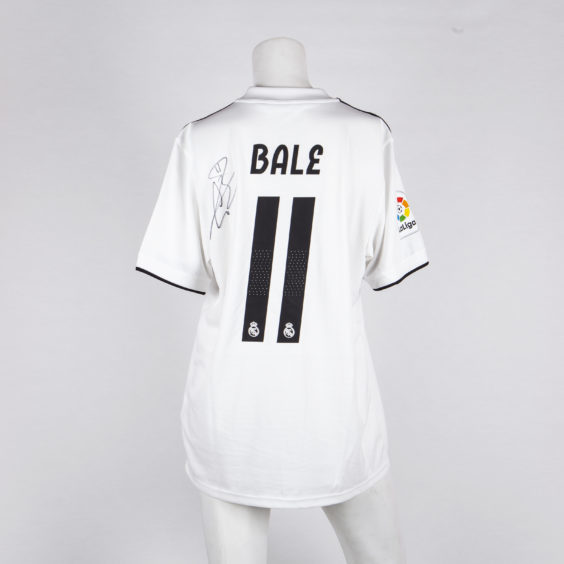 Gareth Bale has signed a Real Madrid shirt with his name on the back