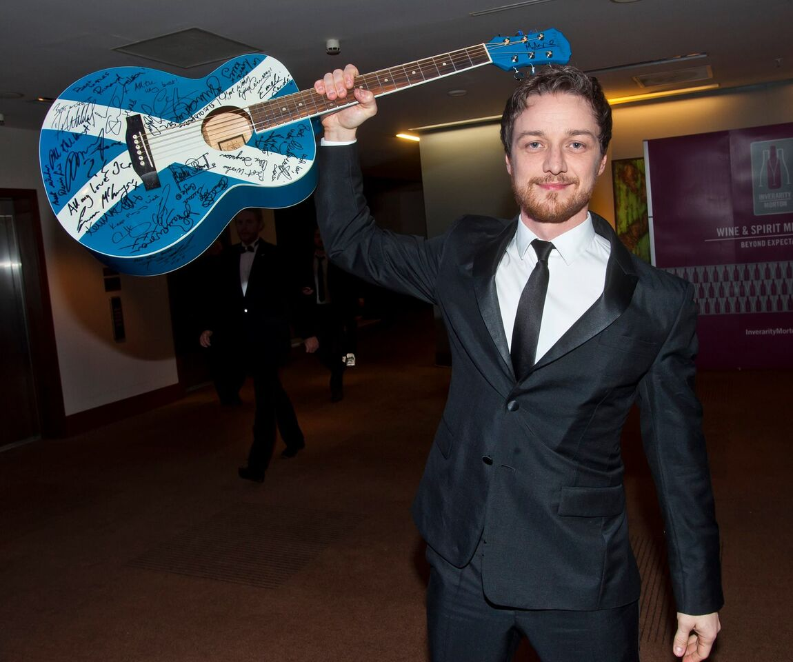 James McAvoy with guitar