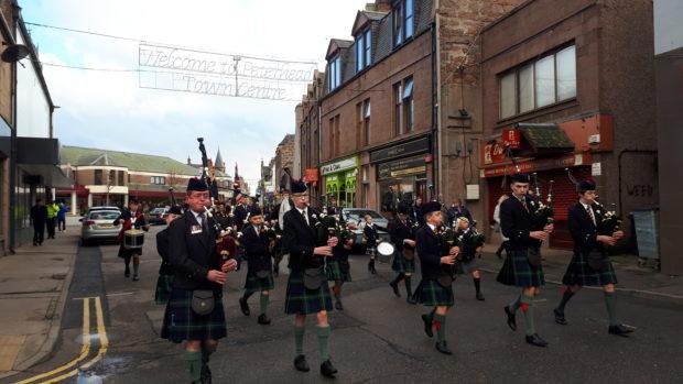 Robert Gordon's College pipe band led the parade around Peterhead.