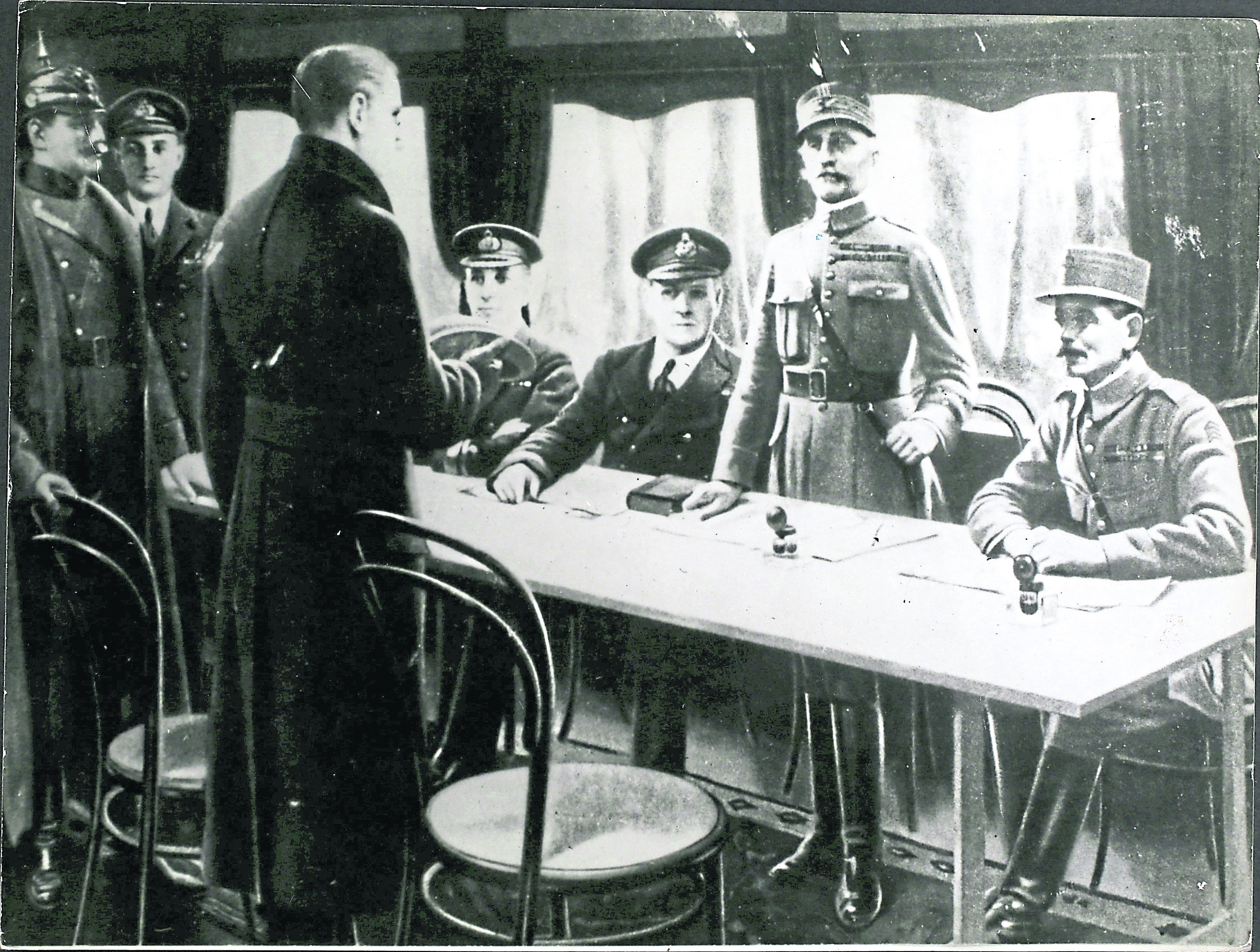 November 11 1918, in a railway coach at Compiegne, France, Supreme Allied Commander Marshal Foch stands to receive the  German plenipotentiaries.