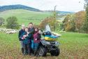 Neil and Debbie McGowan on their farm Incheoch near Alyth with children Tally and Angus.