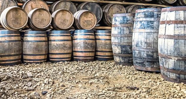 Whisky barrels in warehouse storage.
