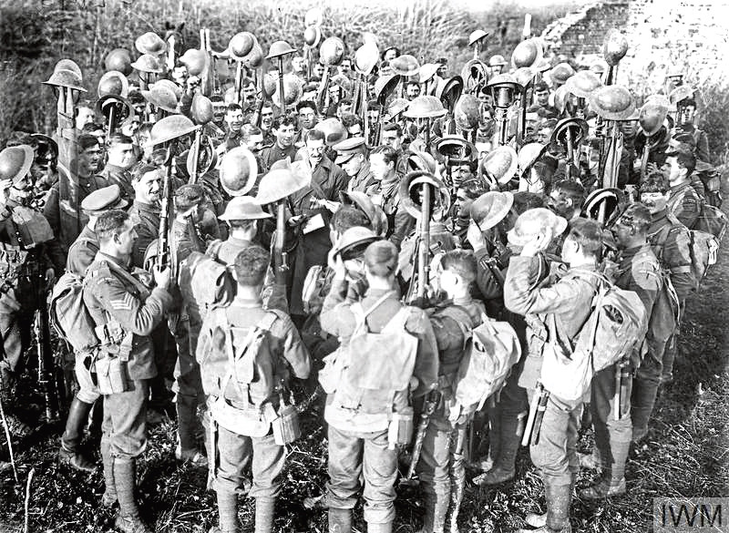 British troops on the Western Front are read the good news about the Armistice.
