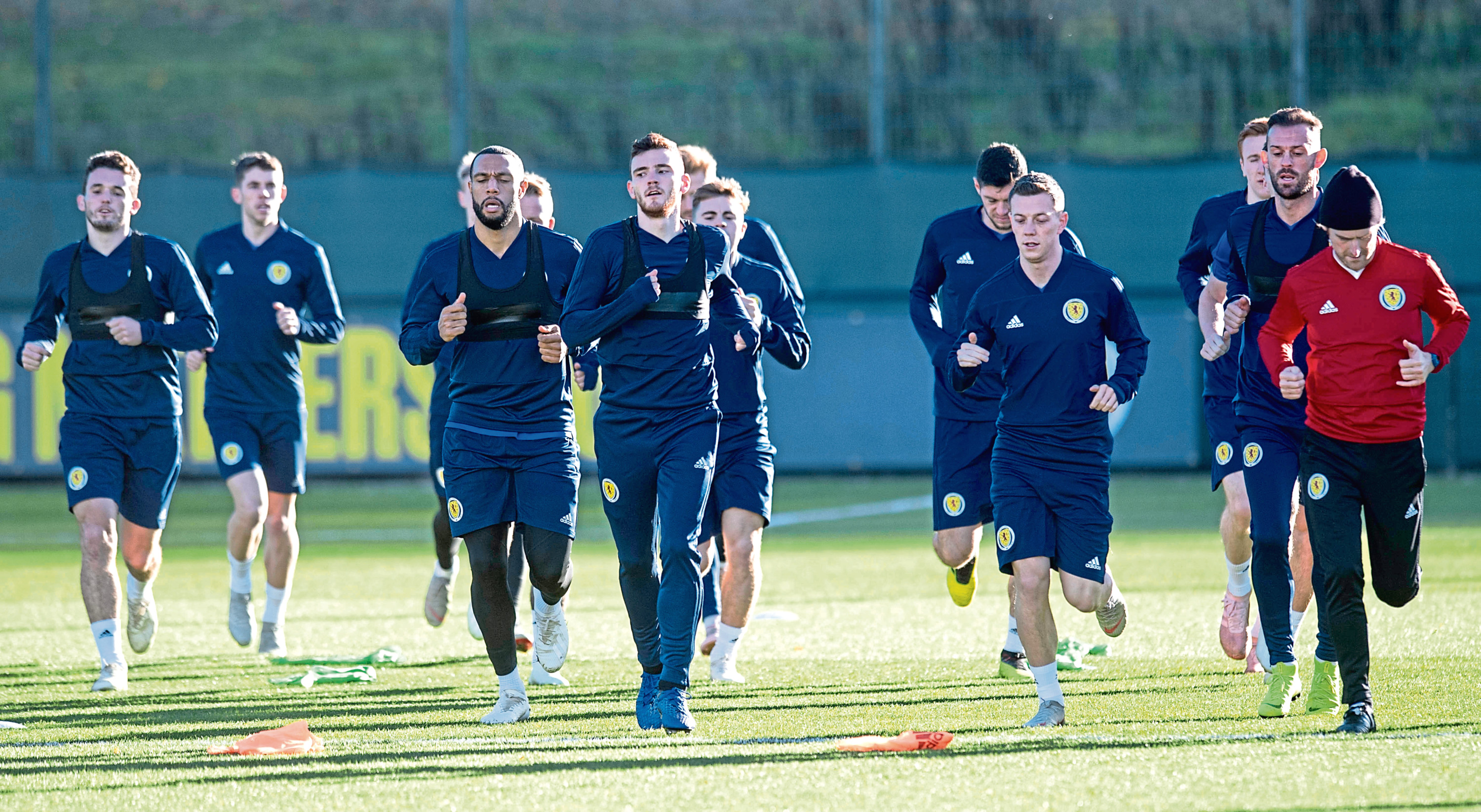 Captain Andy Robertson, centre, leads the Scotland squad during training in Edinburgh yesterday ahead of a crucial Nations League double-header against Israel and Albania.