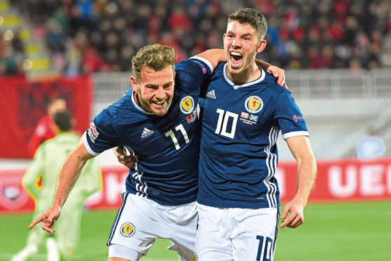 Scotland's Ryan Fraser (L) celebrates his goal with teammate Ryan Christie.