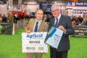 Donald Ross receives his award from Rural Economy Secretary Fergus Ewing.