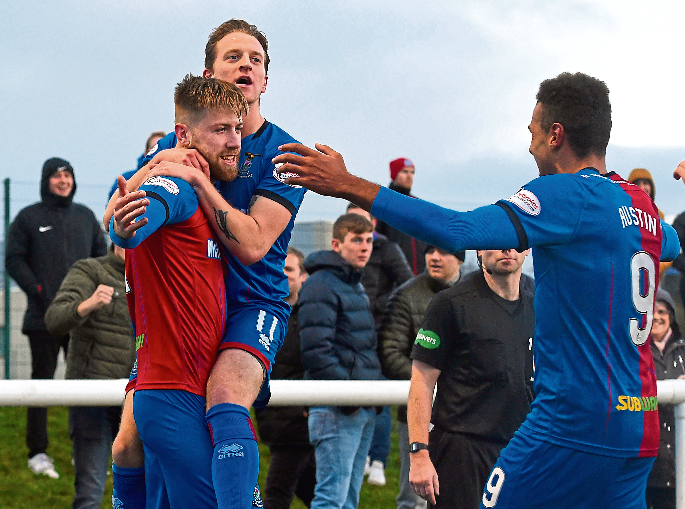 Inverness CT's Shaun Rooney (left) celebrates his goal with Tom Walsh and Nathan Austin (right).