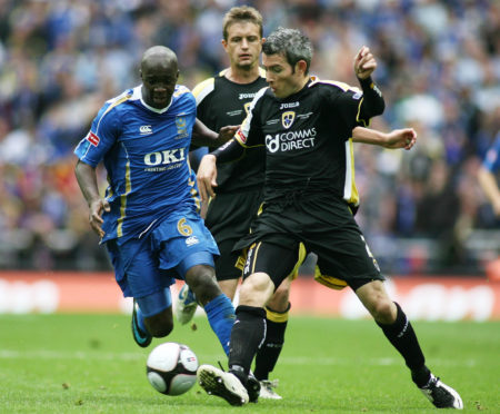 Kevin McNaughton takes on Lassana Diarra (left) in the 2008 FA Cup final