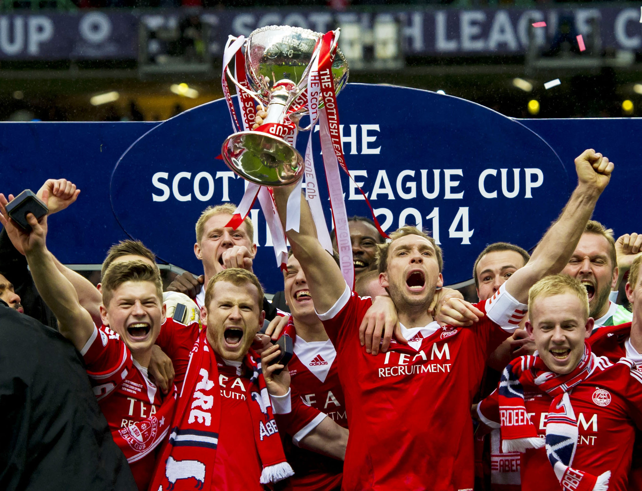 Russell Anderson lifts the trophy after the 2014 League Cup final.
