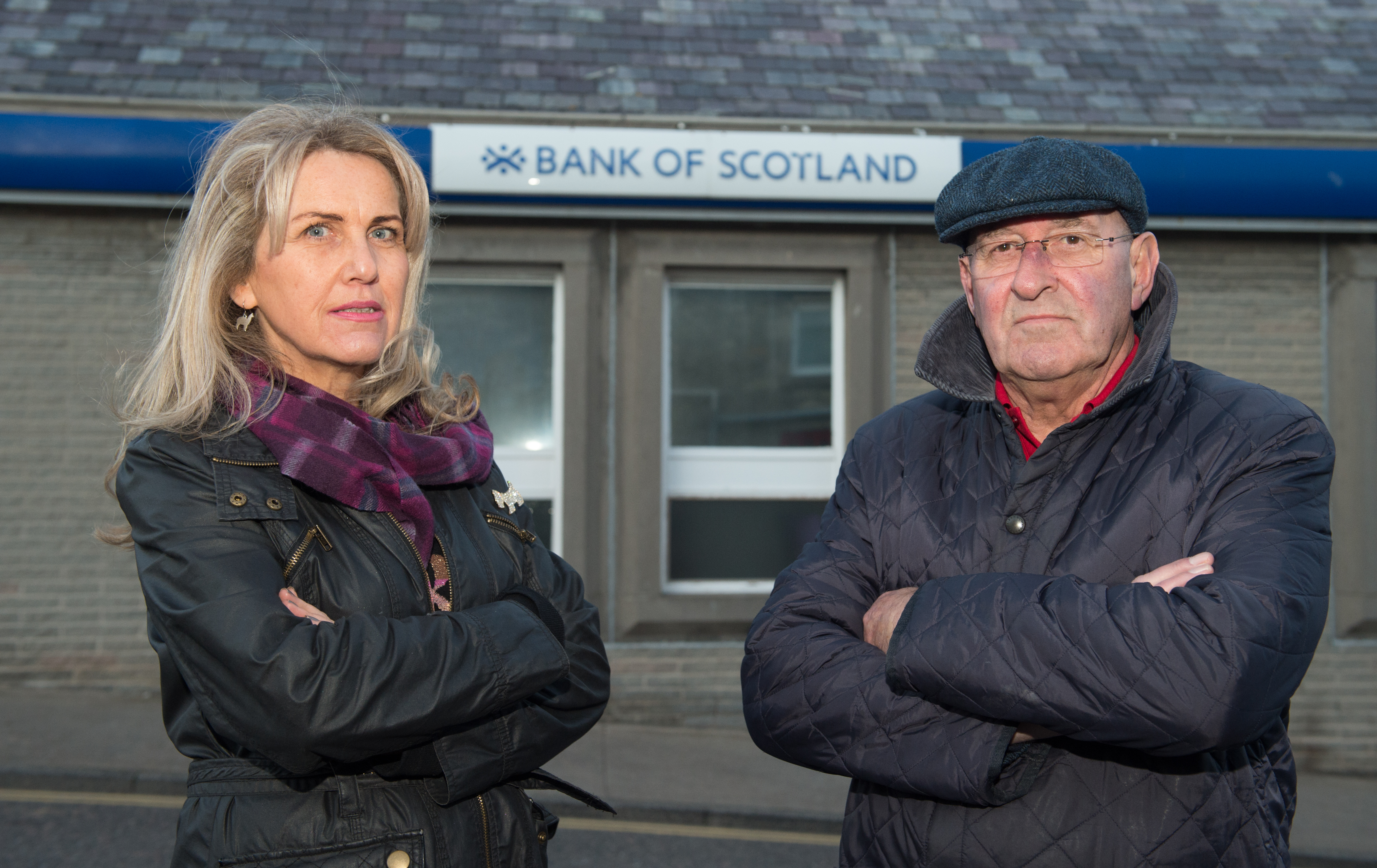 Lossiemouth Community Council vice-chairwoman Carolle Ralph and chairman Mike Mulholland outside Lossiemouth's Bank of Scotland branch.