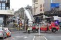 A fire broke out at Bridge Street Apartments in Inverness yesterday morning during rush hour.