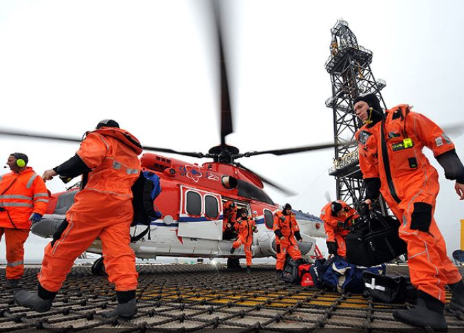 Offshore workers arrive on their platform by helicopter