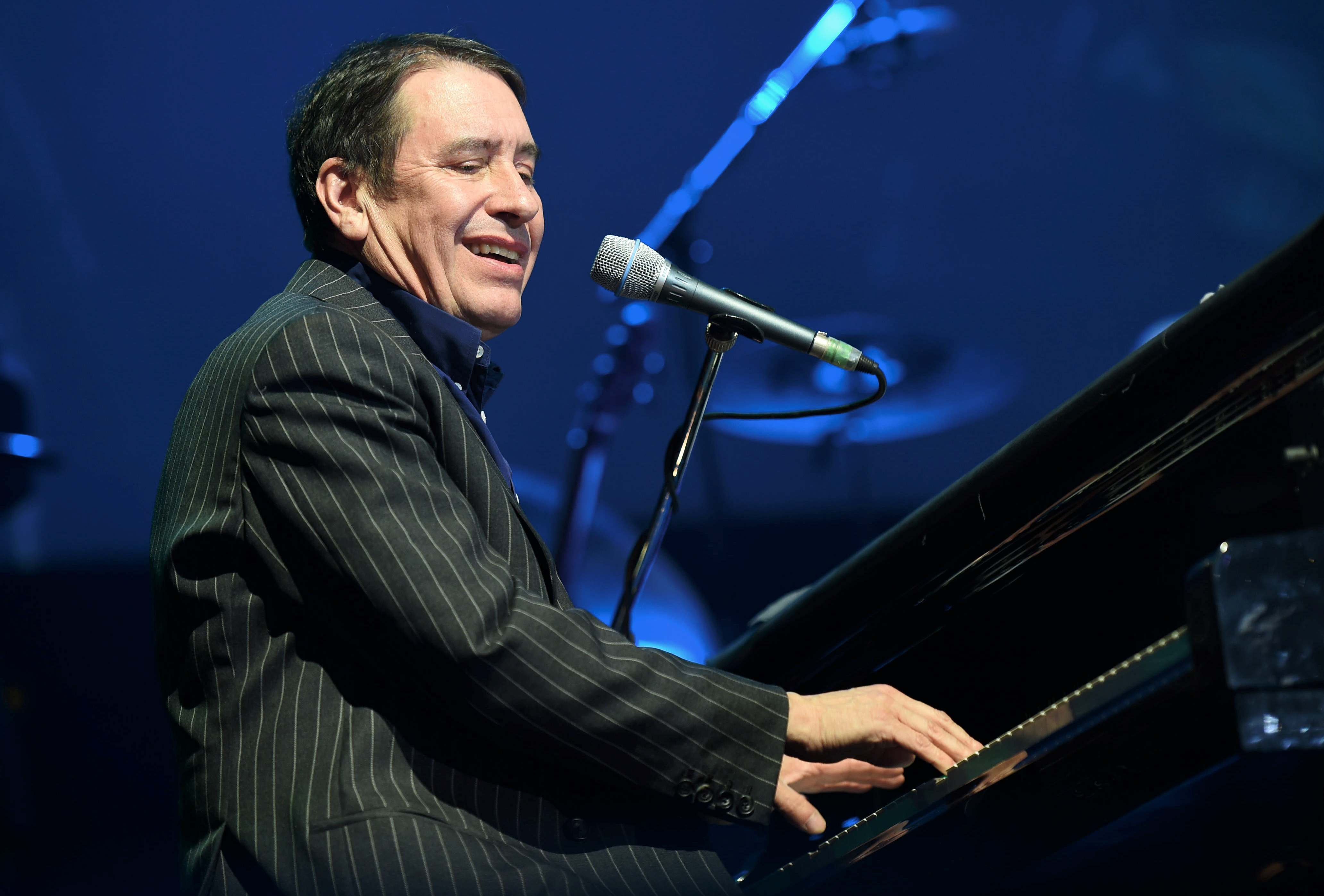 Jools Holland wowed the crowd at the AECC but fans were less impressed with umbrella restrictions as heavy rain fell.