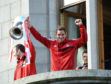 Scott Vernon lifts the trophy with Andy Considine during the 2014 celebration parade.