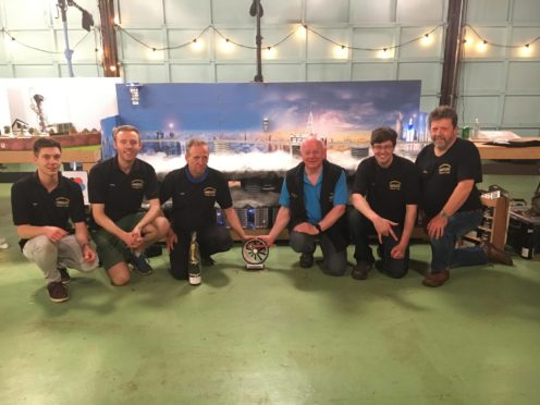 The Aberdeen Model Railway Club team celebrate their win.