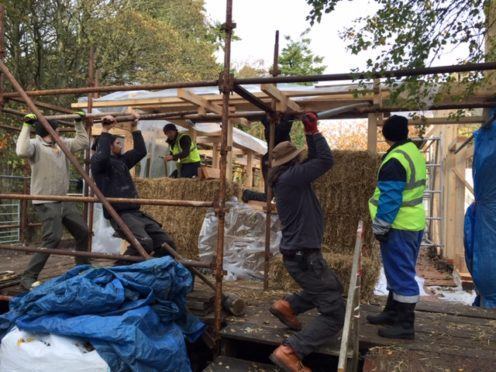 Young adults with learning disabilities have been helping to build a new office from straw bales.