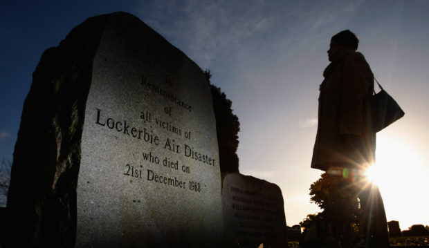 LOCKERBIE, UNITED KINGDOM - DECEMBER 17:  (FILE PHOTO) A member of the public visits the Lockerbie Memorial on December 17, 2008 in Lockerbie, southern Scotland. Convicted terrorist Abdelbaset ali al-Megrahi, has been serving a life sentence for the 1988 Pan-AM flight 103 Lockerbie bombing, which killed 270 people. Megrahi, who is terminally ill with prostate cancer has served eight years of a life sentence, and following the decision today, August 20, 2009 has been released on compassionate grounds to go home to spend his remaining days with his family in Libya. (Photo by Jeff J Mitchell/Getty Images)