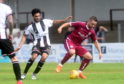 Betfred Cup Arbroath v Elgin City Gayfield Park, Arbroath Pictured are Elgin's Rabin Omar and Arbroath's Ryan Wallace Picture by DARRELL BENNS     Pictured on 21/07/2018