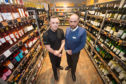 New campaign launched to raise awareness of proxy purchasing alcohol. L2R: Licensing Inspector North-East Division Kenny McGeough and Mark Watkins M&S store manager