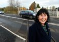 Highland Councillor Margaret Paterson with the now completed Dingwall Middle crossing.