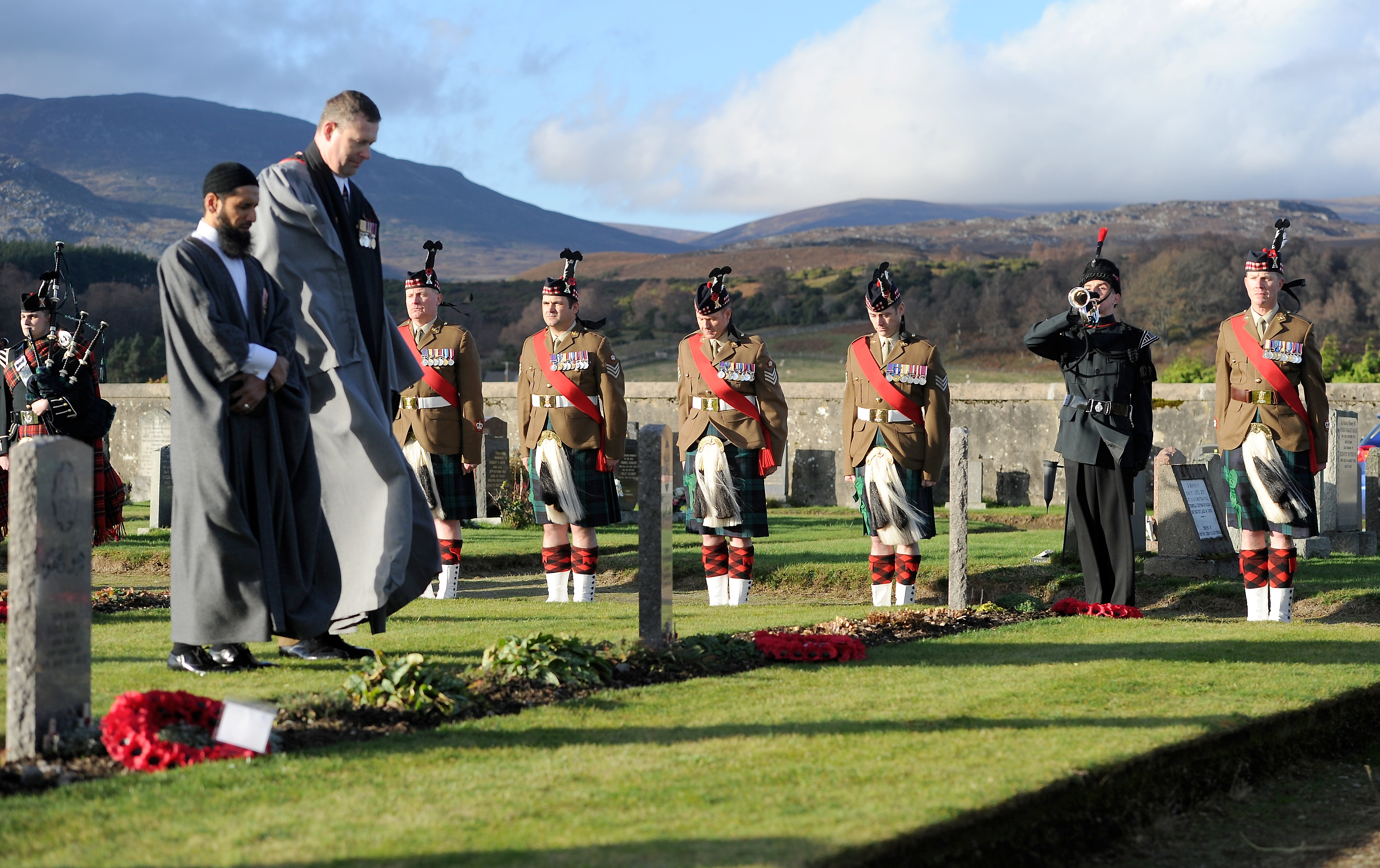 A service of Commemoration and Remembrance was held in Kingussie Cemetery for nine members of the Royal Indian Army Service Corps who in during training during the Second Word War.   A bugler plays the Last Post. Picture by Sandy McCook