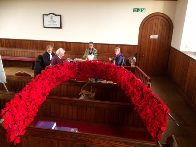 The entrance of Cromdale and Advie Church had been decorated with poppies knitted by the community