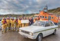 Rossie Murray donates a cheque for £900 to the Thurso lifeboat crew