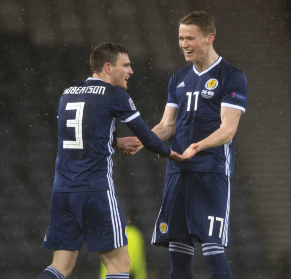 Scotland captain Andy Robertson (left) with Scott McTominay at full time