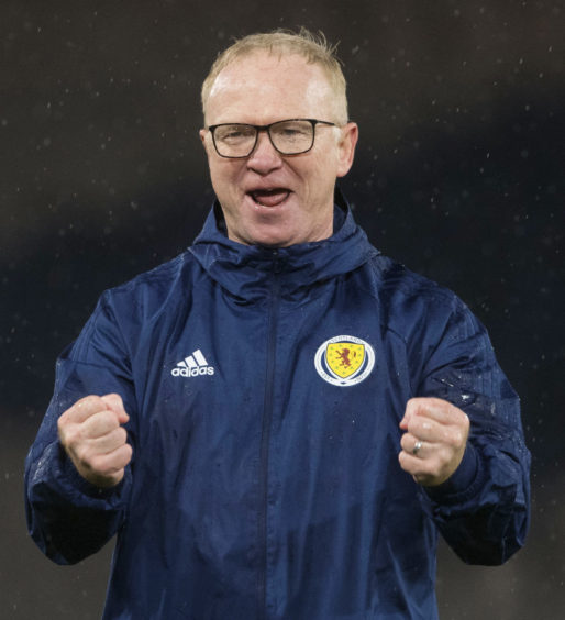 A very happy Scotland manager Alex McLeish celebrates at full time