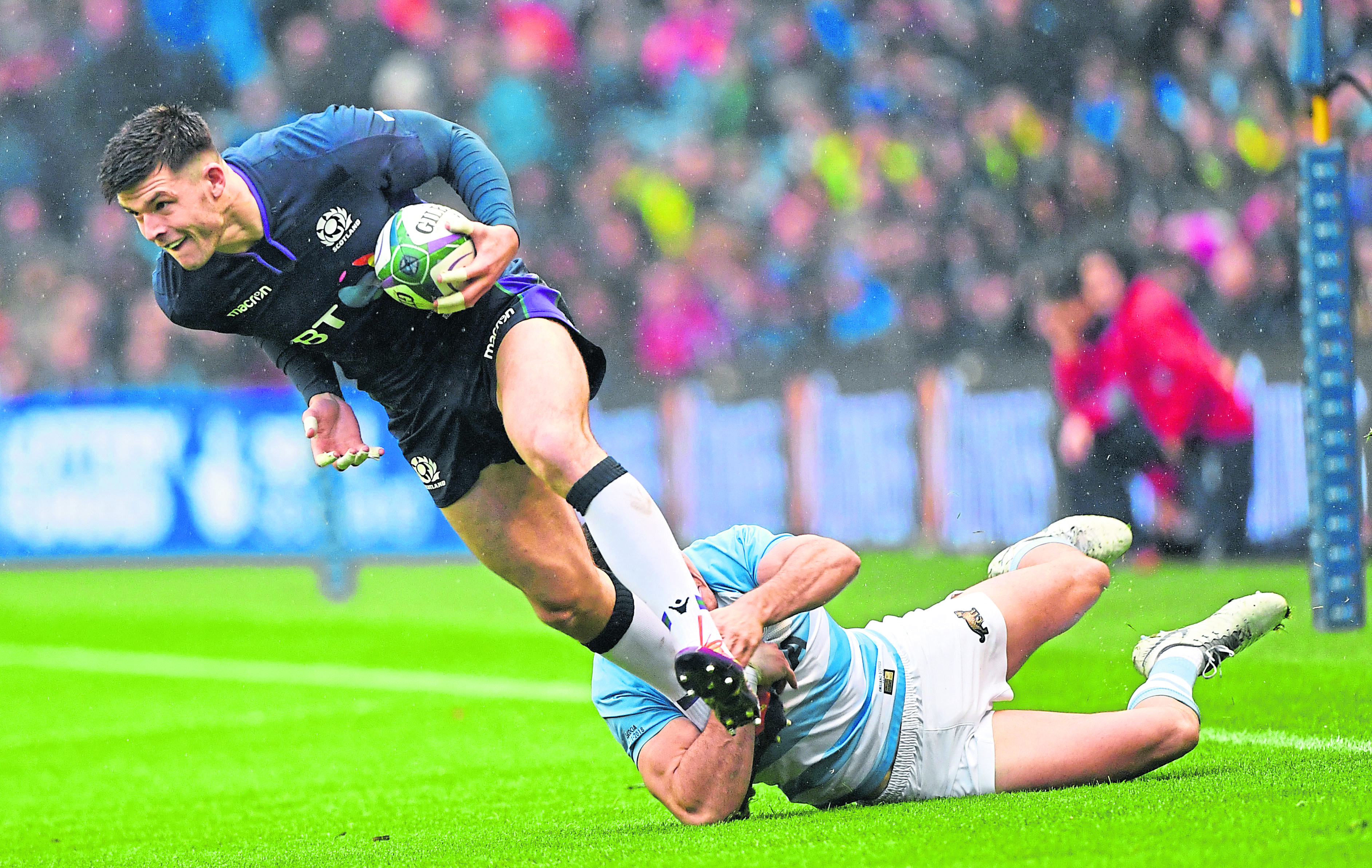 Blair Kinghorn is tackled by Argentinas Tomas Lavanini