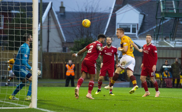 Motherwell's Danny Johnson heads home to make it 2-0