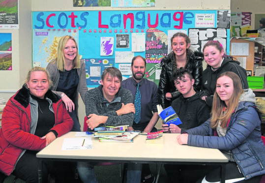 Banff Academy have teamed up with Aberdeen University to examine the benefits of studying towards the Scots Language Award. From left, Libby Wilson, the university's Claire Needler, poet and novelist Matthew Fitt, Humanities teacher Dr Jamie Fairbairn, Emma Twatt, Richie Duncan, Jaymi Sivewright and Ellie Narron. Picture by Kath Flannery.